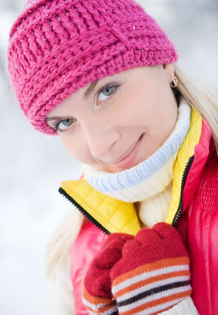 Beautiful young blond in winter forest close-up portrait photo