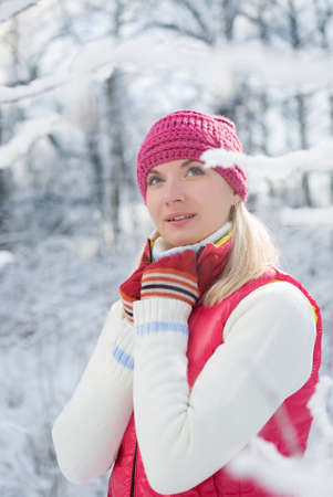 Beautiful young woman in winter forest photo