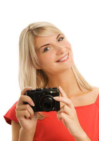 Beautiful smiling woman with digital camera. Isolated on white background photo
