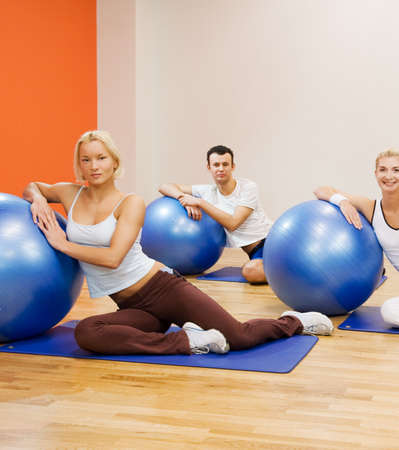 Group of people doing fitness exercise with a ball Stock Photo - 4143413