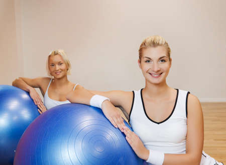 Group of people doing fitness exercise with a ball Stock Photo - 4143420