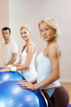 Group of people doing fitness exercise with a ball Stock Photo - 4143421