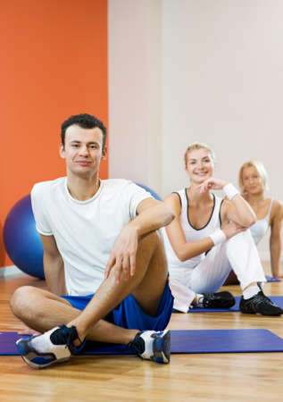 Group of people relaxing after fitness exercise photo