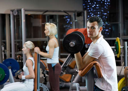 Group of people working out in a gym Stock Photo - 4143382