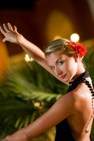 Beautiful young woman dancing tango photo