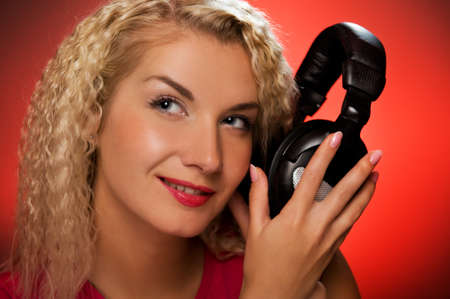 Blond woman listening to the music Stock Photo - 4182986