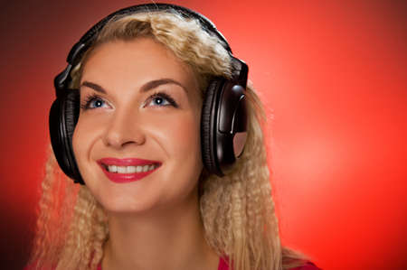 Blond woman listening to the music Stock Photo - 4182979