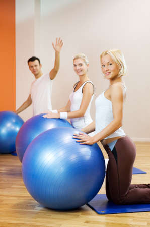 Group of people doing fitness exercise with a ball Stock Photo - 4197785