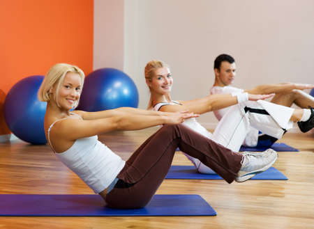 Group of people doing fitness exercise with a ball Stock Photo - 4197787