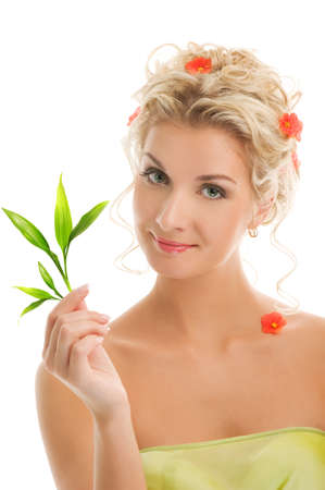 Beautiful blond woman with young plant. Isolated on white background Stock Photo - 4197799