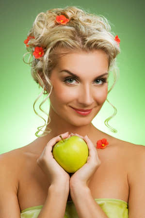 Beautiful young woman with ripe green apple Stock Photo - 4197805