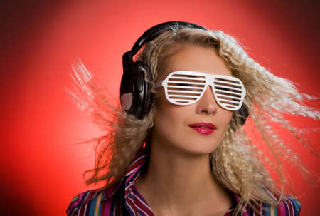 Stylish blond woman with shutter glasses and headphones Stock Photo - 4197821