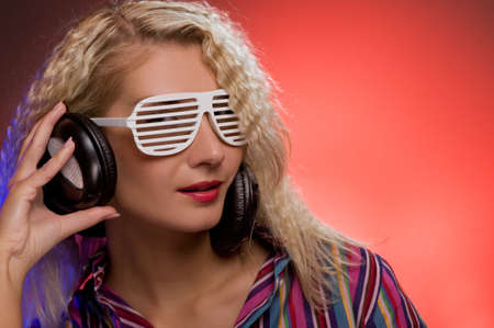 Stylish blond woman with shutter glasses and headphones Stock Photo - 4197823