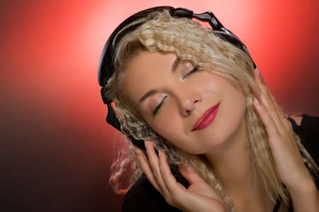 Blond woman listening to the music Stock Photo - 4197820