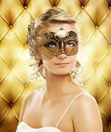 sexual abstract: Beautiful woman in carnival mask over abstract background Stock Photo