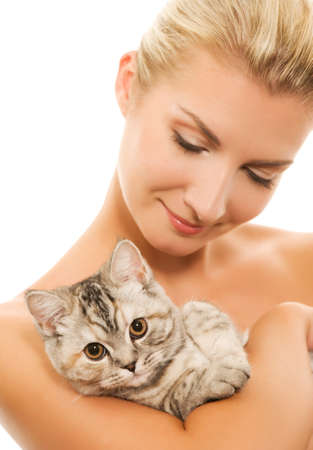 Beautiful young woman with adorable kitten (focus on kitten) photo