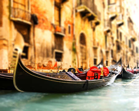 Traditional Venice gandola ride (shallow DoF, focus on gandola) photo