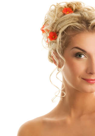 Beautiful young woman with fresh spring flowers in her hair. Spring concept. photo