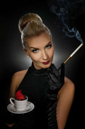 Charming lady with coffe cup and mouthpiece photo