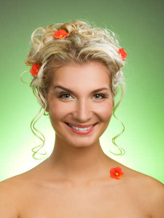 Beautiful young woman with fresh spring flowers in her hair. Spring concept. Stock Photo - 4231155