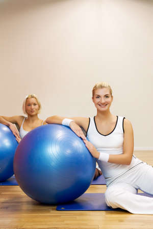 Group of people doing fitness exercise with a ball Stock Photo - 4250537