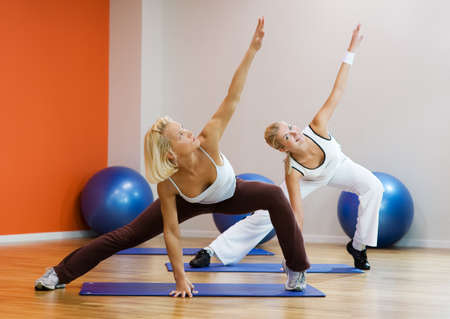 pilates: Group of people doing fitness exercise Stock Photo