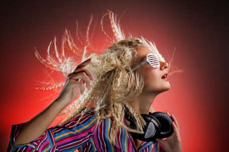 Beautiful woman with headphones dancing Stock Photo - 4256543