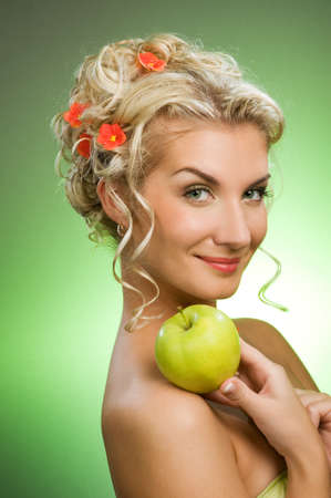 Beautiful young woman with ripe green apple photo
