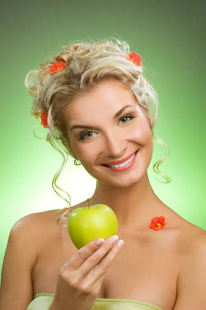 Beautiful young woman with ripe green apple Stock Photo - 4256539