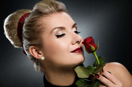 Charming lady with red rose Stock Photo - 4276639