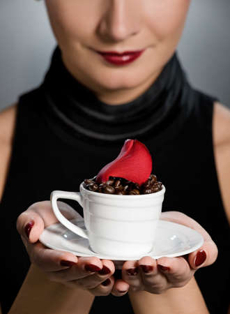 Lady with coffe cup photo