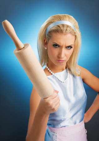 Angry housewife with rolling pin Stock Photo