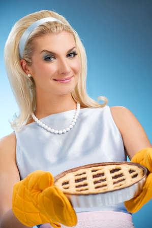 Beautiful woman holding hot italian pie. Retro stylized portrait Stock Photo - 4276668