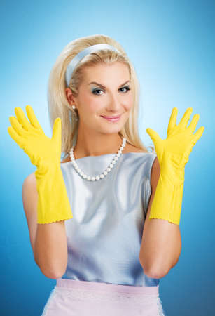 rubber gloves: Beautiful happy housewife with rubber gloves