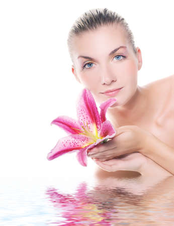 Beautiful woman with lily flower reflected in water Stock Photo - 4290819