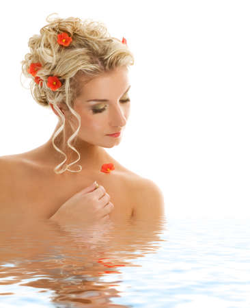 Beautiful young woman with fresh spring flowers in her hair reflected in water Stock Photo - 4290809