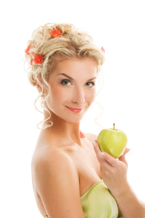 Beautiful young woman with ripe green apple. Spring concept photo