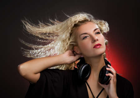 trance: Beautiful young woman with headphones Stock Photo