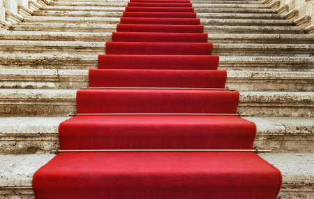 Ancient stairs covered with red carpet photo