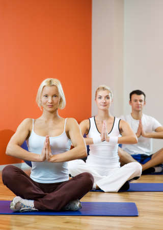Group of people doing yoga exercise Stock Photo - 4355175