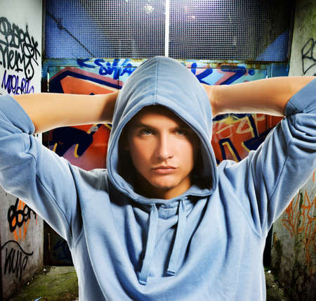 Cool looking hooligan in a graffiti painted gateway Stock Photo - 4355195