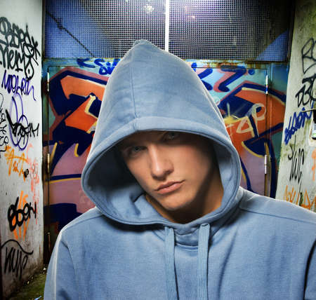 Cool looking hooligan in a graffiti painted gateway Stock Photo - 4355197