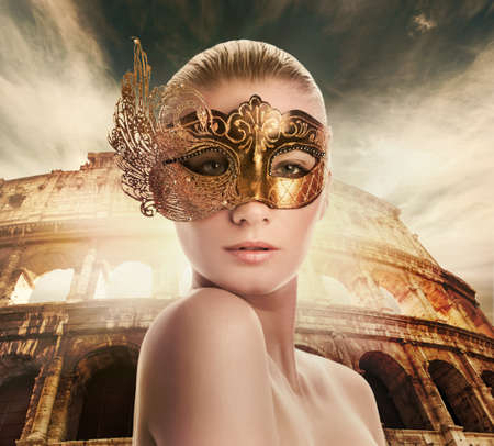 roman amphitheater: Beautiful woman in front of Colosseum (Rome, Italy)