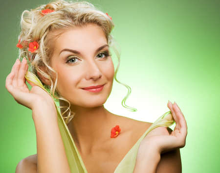 Beautiful young woman with fresh flowers in her hair. Spring concept.   Stock Photo - 4365734