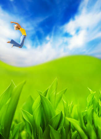 Beautiful young woman jumping in the field photo
