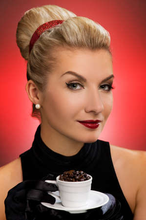 Beautiful lady drinking coffee. Retro portrait photo