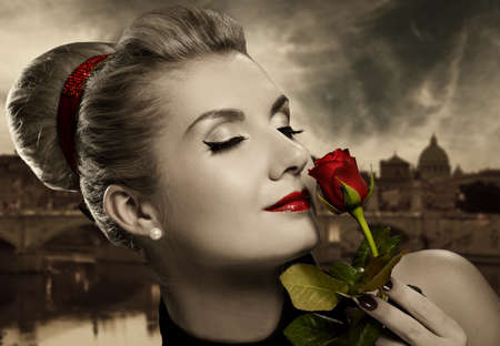 classic woman: Beautiful young woman with red rose. Retro potrait Stock Photo