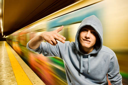 Young criminal in subway Stock Photo