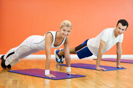 Group of people completing push ups Stock Photo