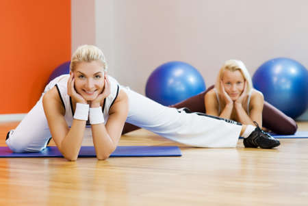 Group of people doing stretching exercise Stock Photo - 4410732